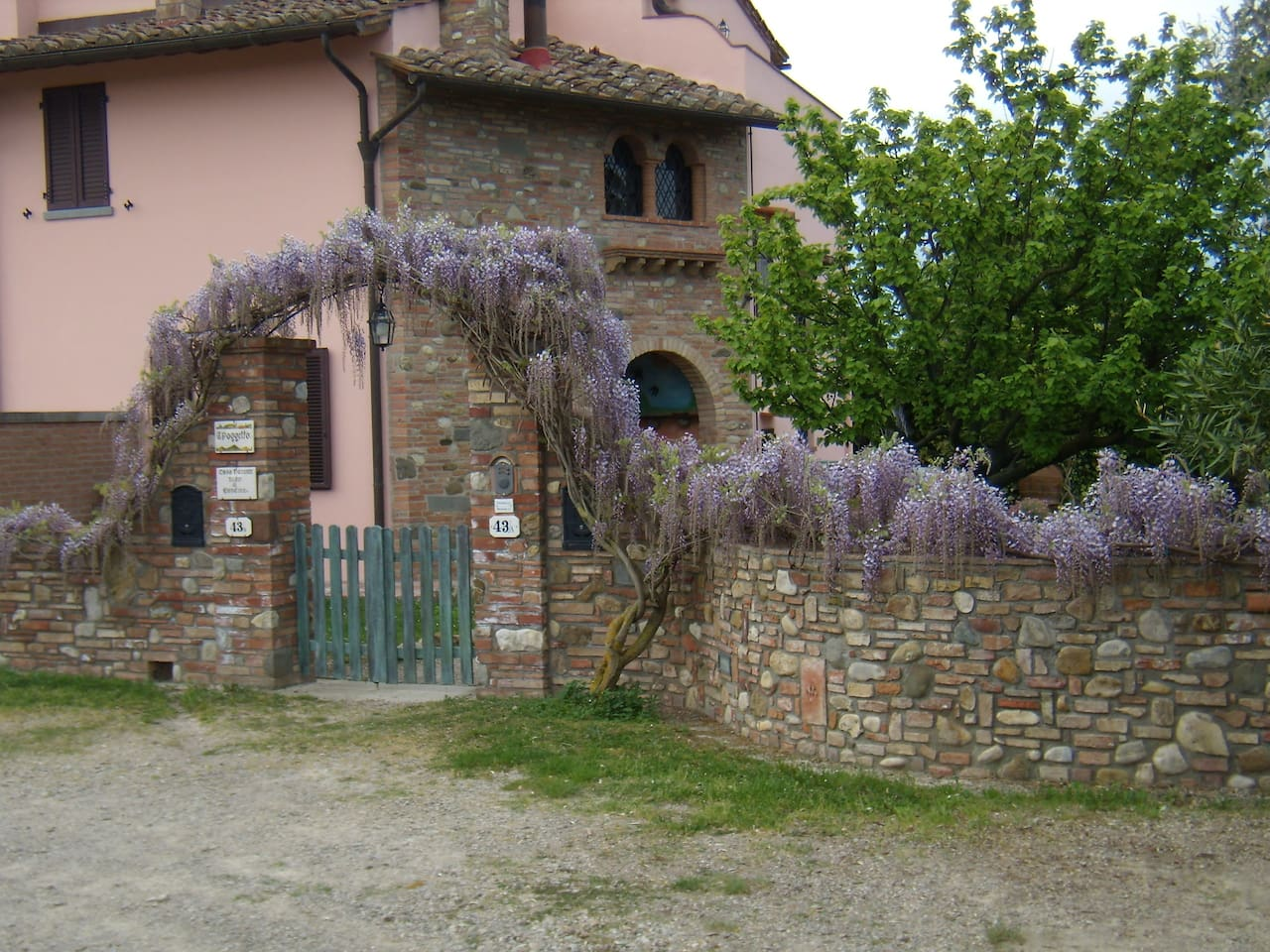 View of the house from the parking lot - and with blooming wisteria :)