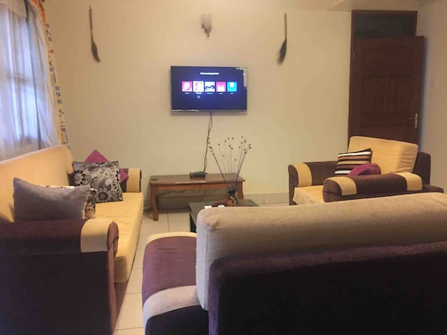 Living room with Smart TV to enable u watch a Netflix and other streaming channels