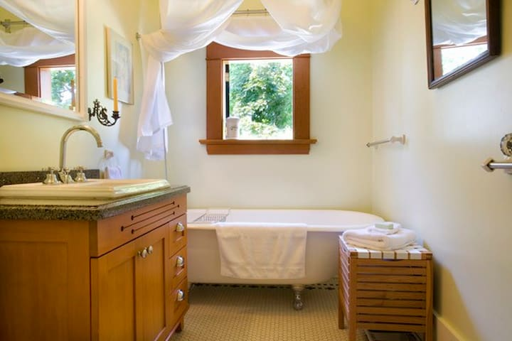 Full bathroom with clawfoot tub and shower, & hotel quality towels.