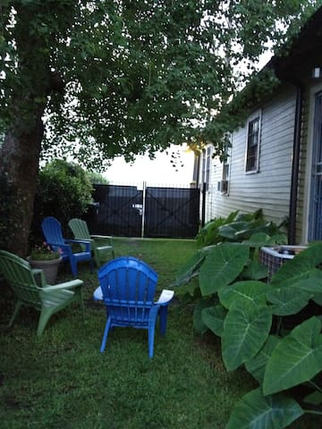 Shady, private side yard for relaxing.