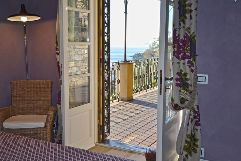 Doors opening up to private terrace with seaview