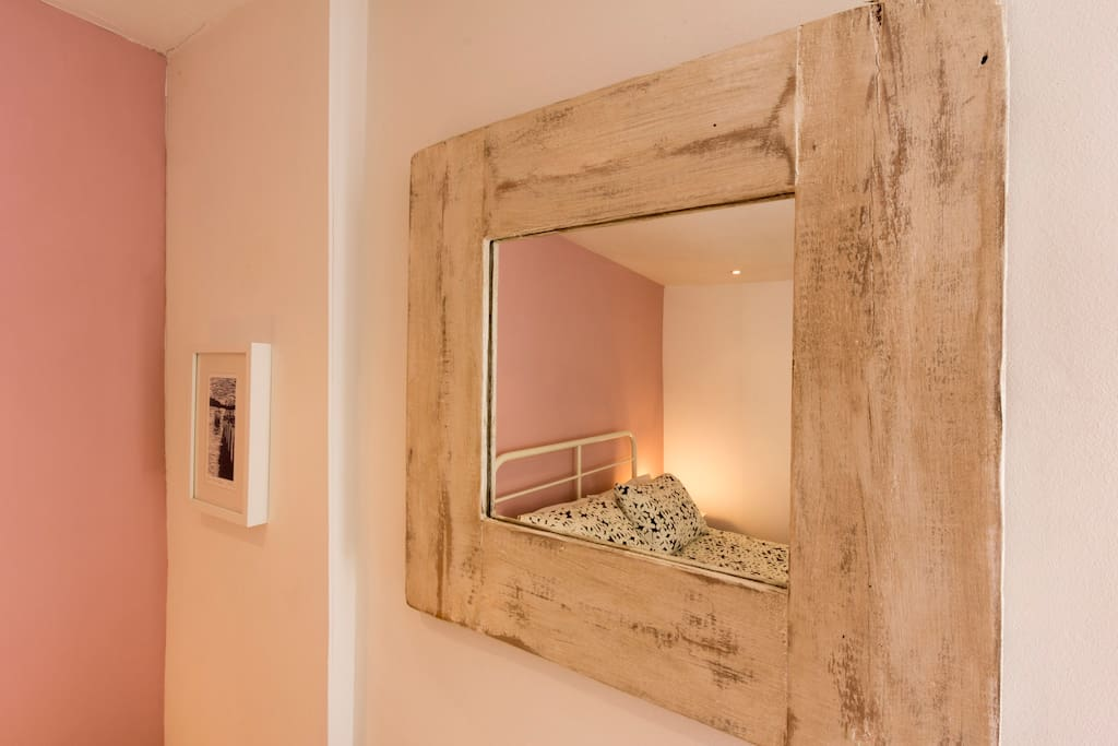 Mirror in double bedroom at the back of the cottage