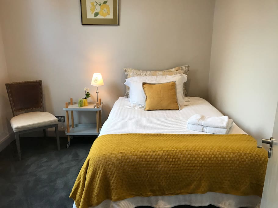 The bedroom with a petite double bed.