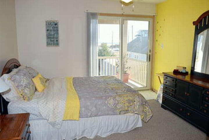 Queen room with large private deck with beautiful ocean views. Dedicated bathroom down the hall.