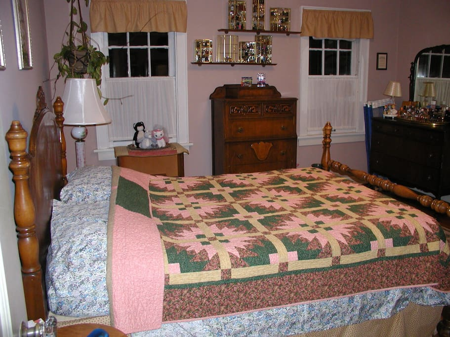 Guest room large double bed antique head and footboard.