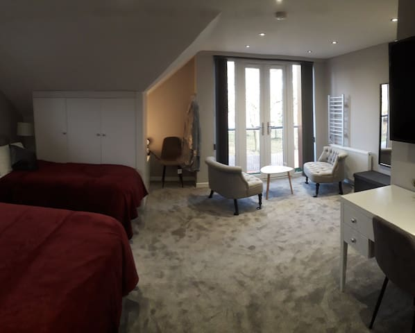 Portobello Family Suite - Options for 3 single beds or superking bed and one single with privacy curtain divider.