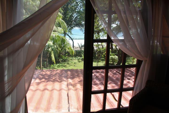 View of ocean from 2nd floor bedroom