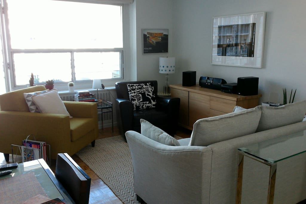 Living room area, with bright, sunny views.