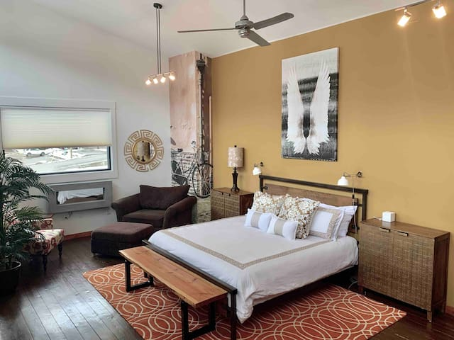 Grand Loft master bedroom with quality king bed & comfy private lounge