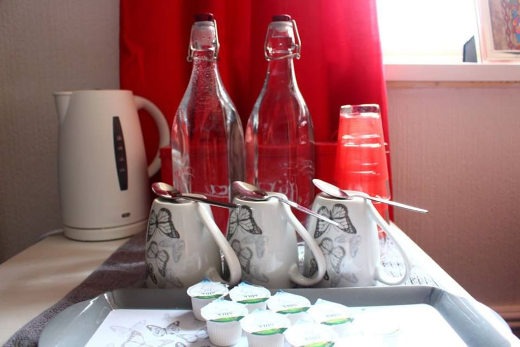 Tea, Coffee and kettle plus bottled water.