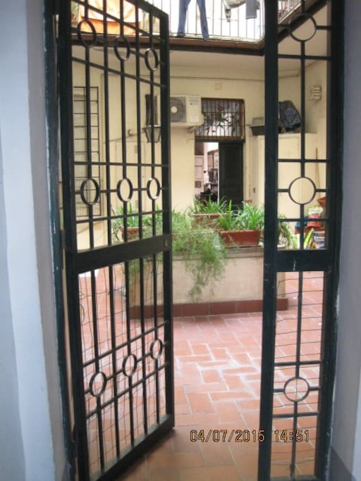 Entrance to the apartment is through a gated door that leads into a courtyard