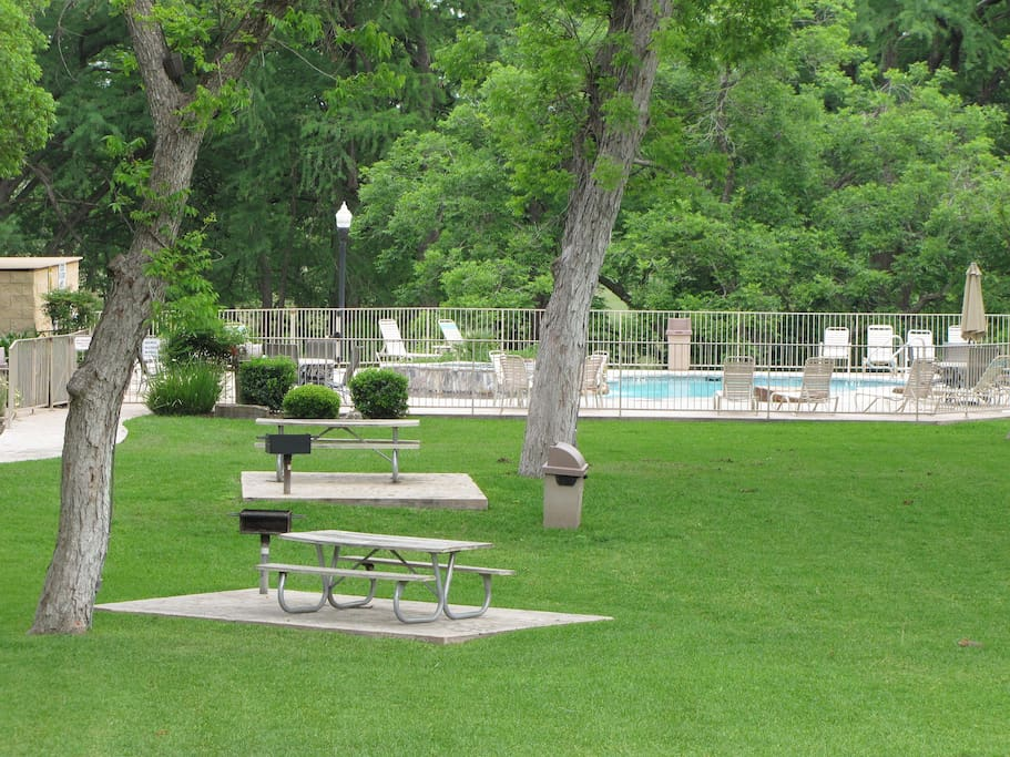 Beautiful 5 acre Pecan bottom with picnic tables and barbecue pits.