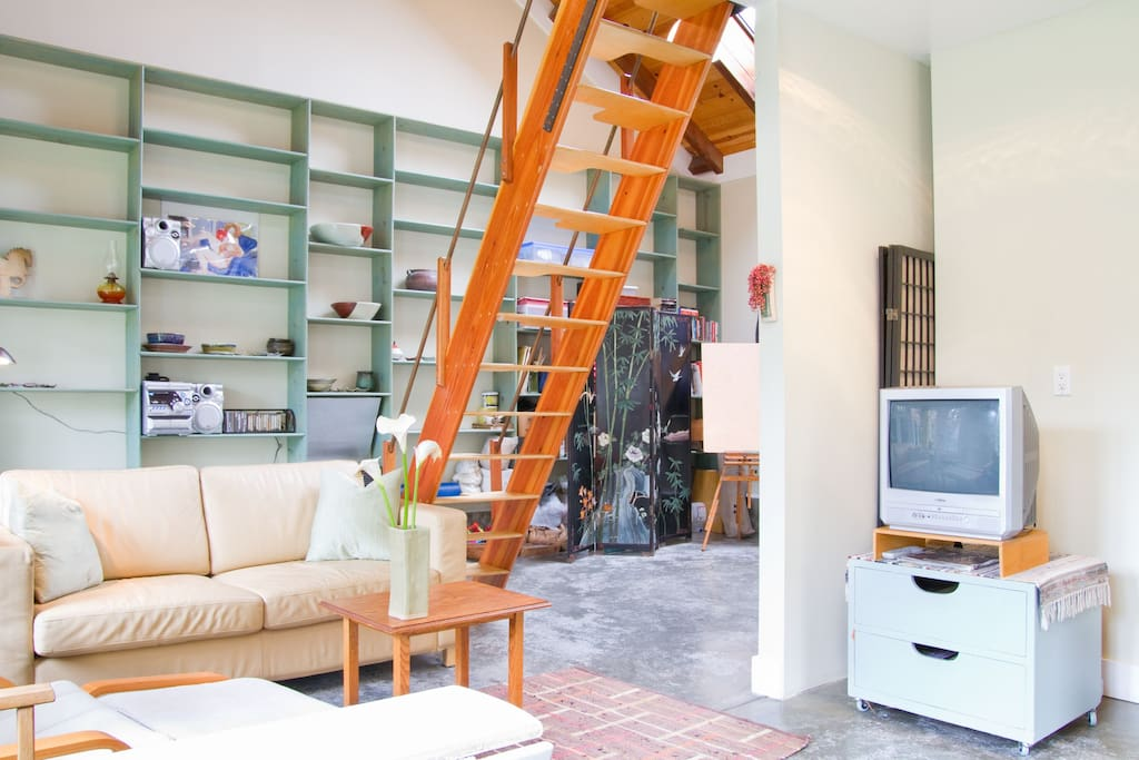 Stairway to Loft Bedroom, and sofa/bed opens to comfortable double bed