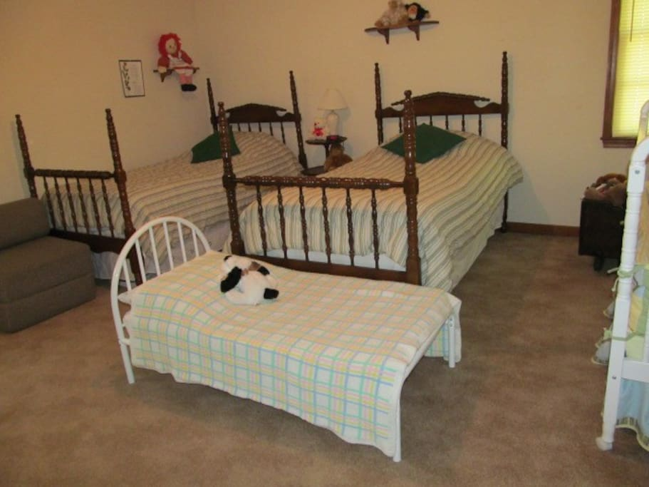 2 twin beds, a toddler bed  & crib