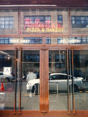 "Famous ""Roberta's Pizza"" Restaurant take out entrance door."