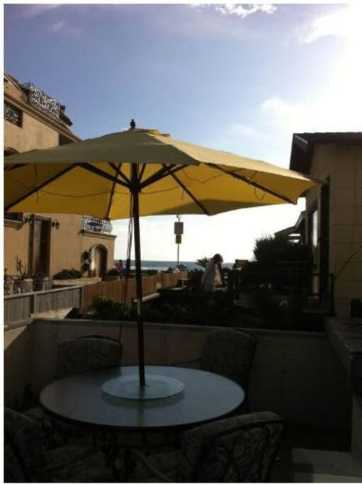 Patio BBQ courtyard with ocean, boardwalk views, semi-private. Unit also has its own private deck.