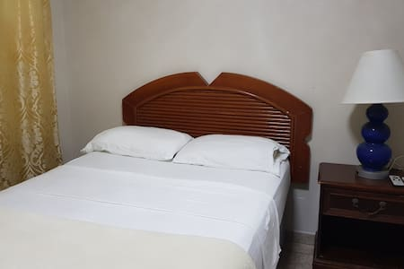 This is a guestroom, equipped with one full-size bed, air condition, refrigerator, television, closet and private bath.