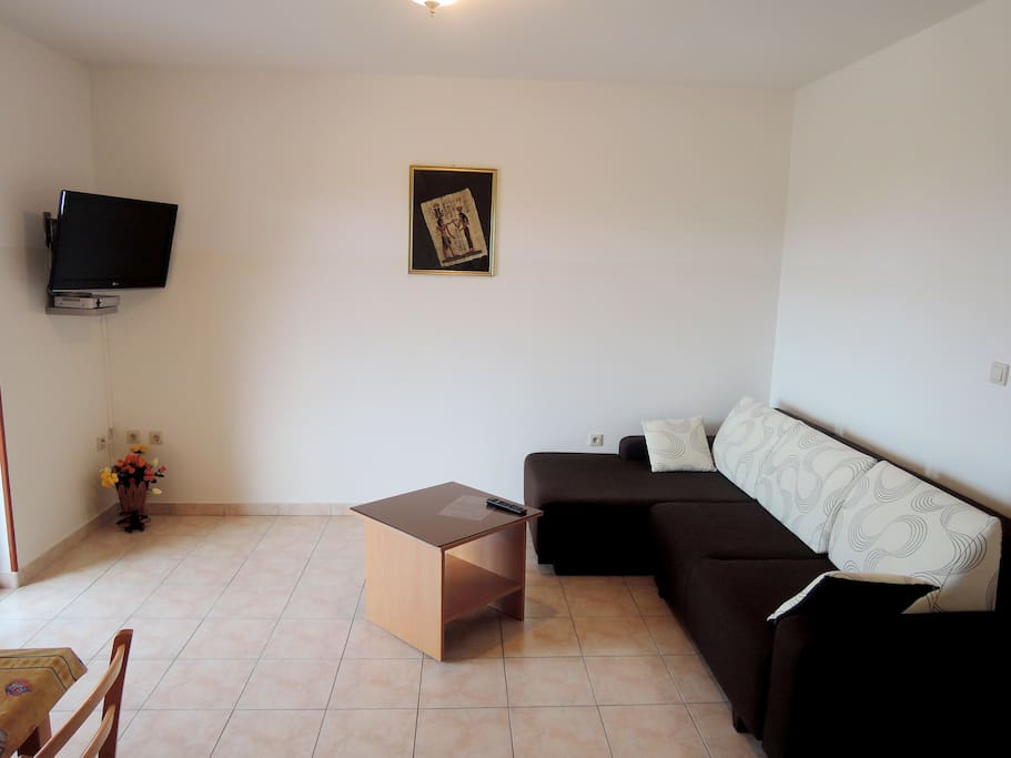 Living area with sofa bed and TV/SAT
