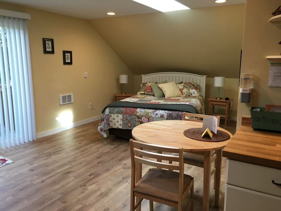 Comfy queen size bed in roomy studio apartment.  The studio is separate from our own residence, giving you whatever level of privacy you may want.