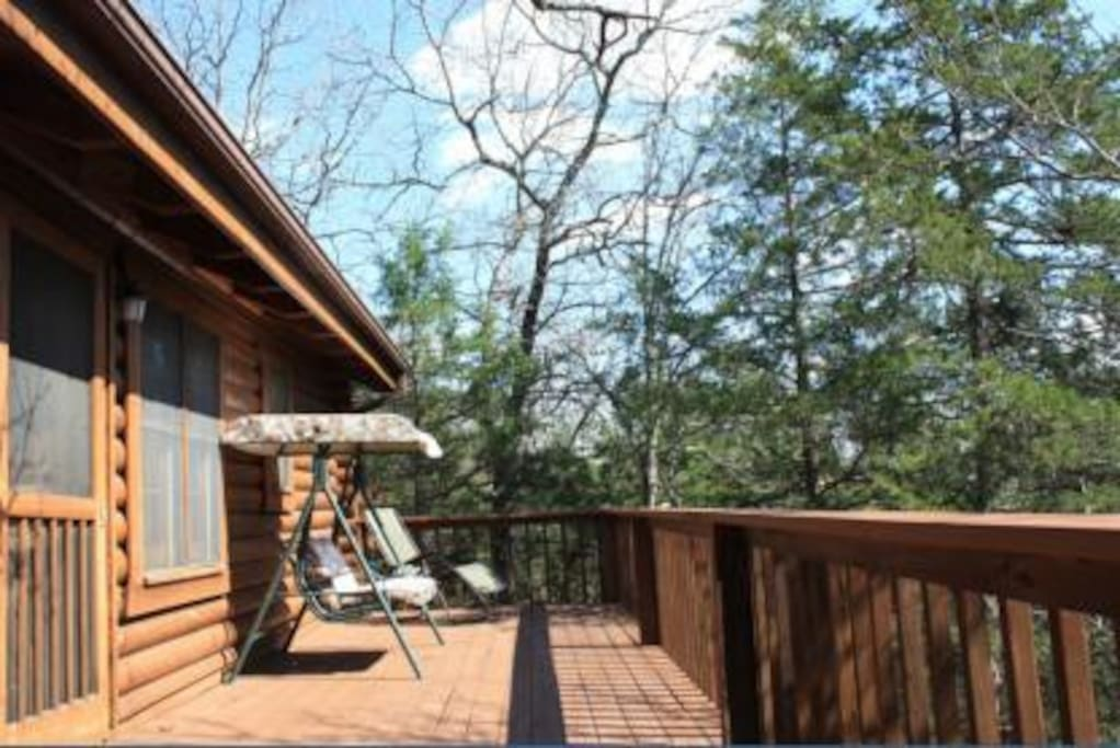 Back deck has nice view of surrounding trees