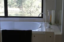 Your very own private bathroom with shower, 2 person spa and adjacent private toilet. Why not enjoy a relaxing spa with views out onto the landscape below and the setting sun? A glass of wine can add to the whole experience.