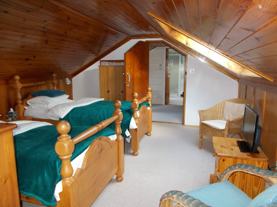 Our attic twin room with private shower room and great views of loch and hills.