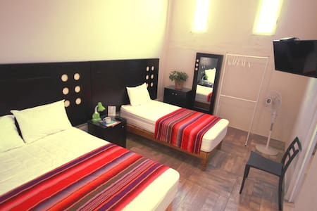 Habitacion Con cama matrimonial e individual
