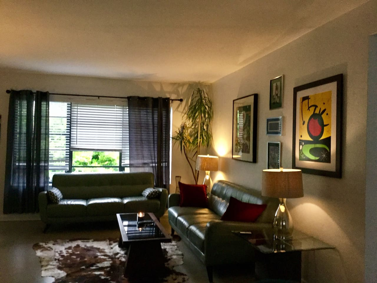 Two beautiful mid century style leather sofas great art feel like Your on Mad Men