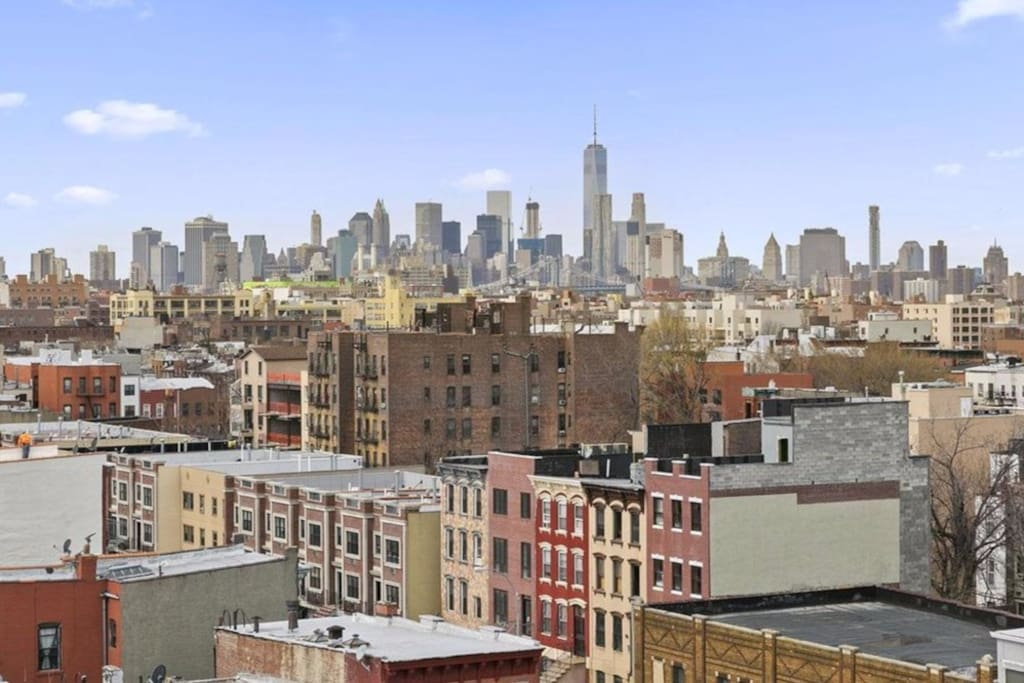 There is a stunning view of the NYC Skyline and Downtown Brooklyn.