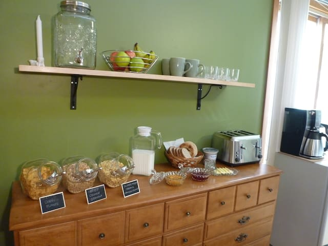 Coffee, Tea, Cereal, Fruit, Jams and Bread on the breakfast buffet
