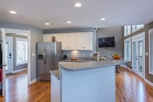 Large kitchen opens up to dining area.