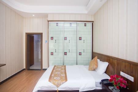 温馨家庭套房 - Zhangjiajie - Lägenhet