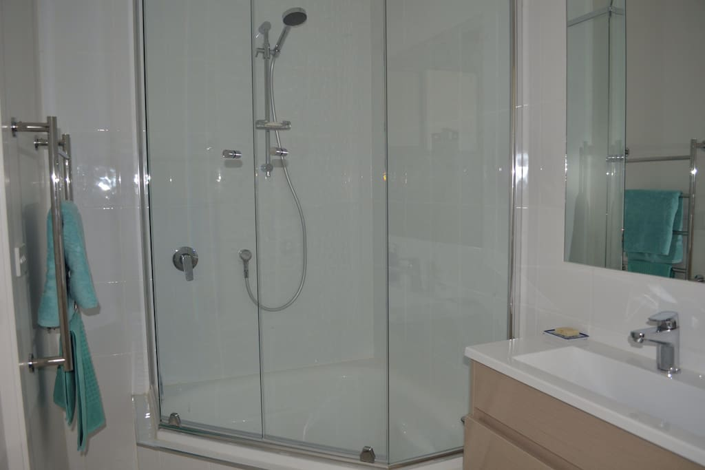 Your bathroom with small corner bath, toilet and heated towel rail.