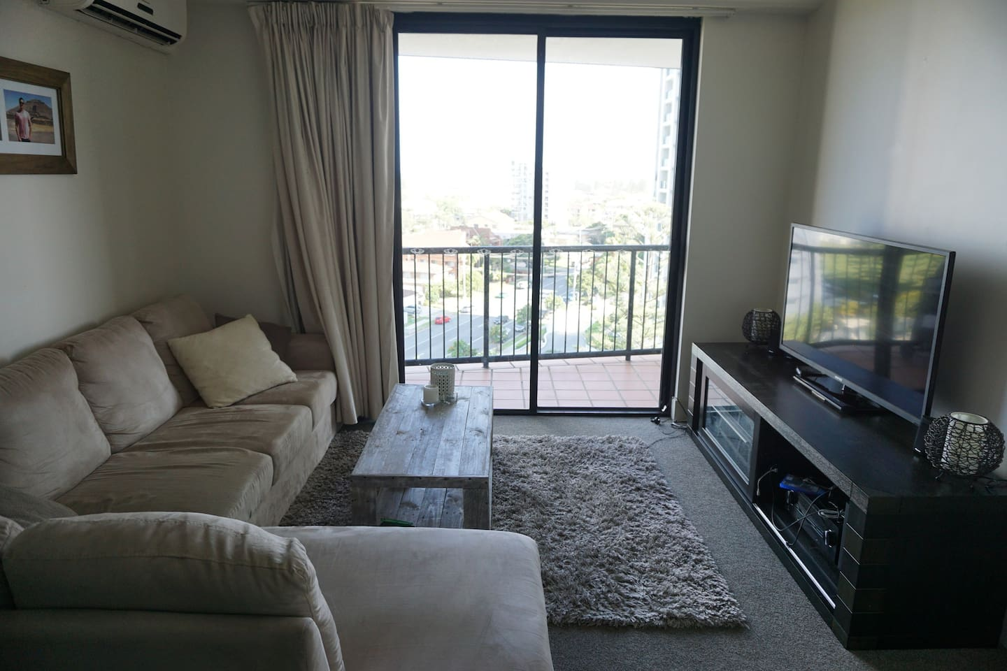Huge comfortable couch and TV