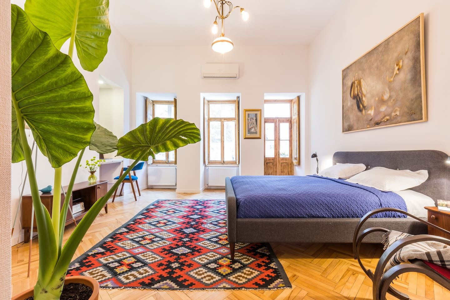 The bedroom is specious and bright, but if the sunlight will bother you, there are beautiful blinds on the windows. They create a vintage atmosphere in the room. We specially preserved them from the old apartments.
