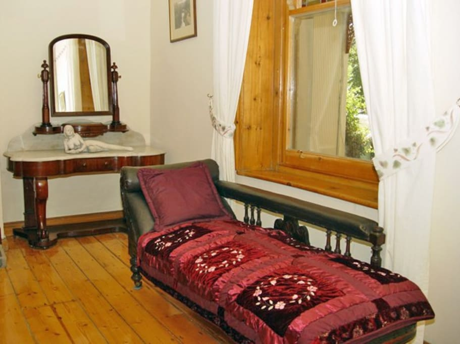 Bedroom has period miners couch and other period furniture