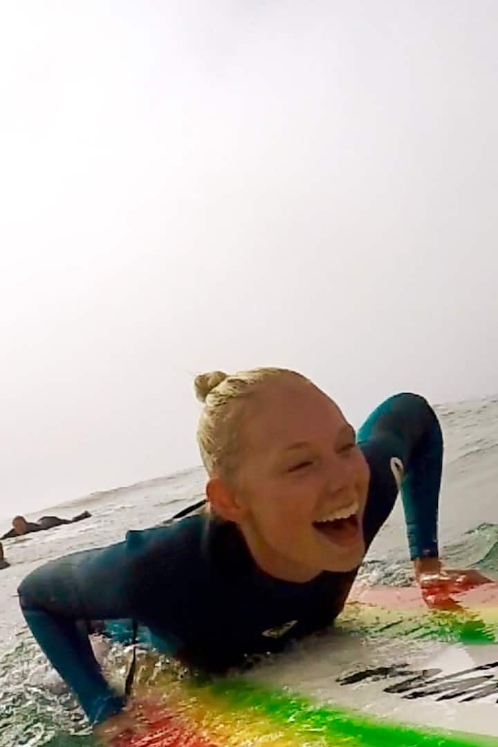 all smiles catching waves!