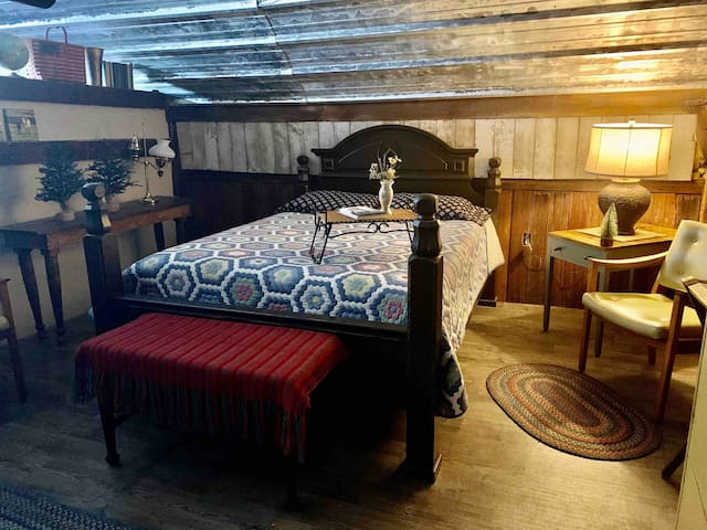 Bedroom 1 includes a queen bed and comfortable seating area for reading or resting.