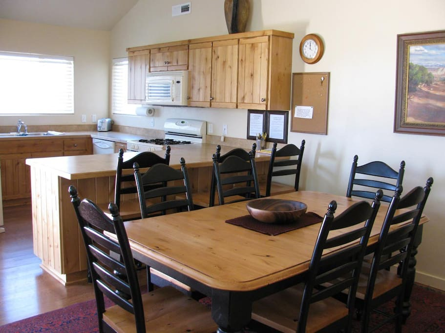 Lofted ceilings and bright, kitchen, with plenty of counter space and seating for 9.