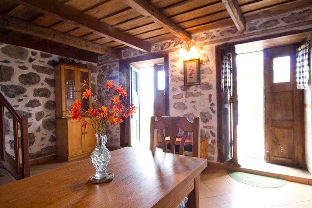 Downstairs of la Casita with double doors opening out onto patios and panoramic sea view