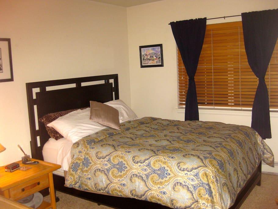 1 Bedroom w/ queen bed, dresser, closet, attached bathroom