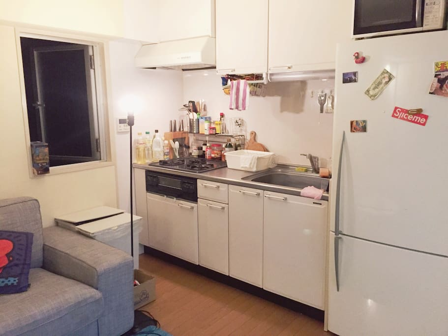 Big kitchen with 3 gas cooking stoves.