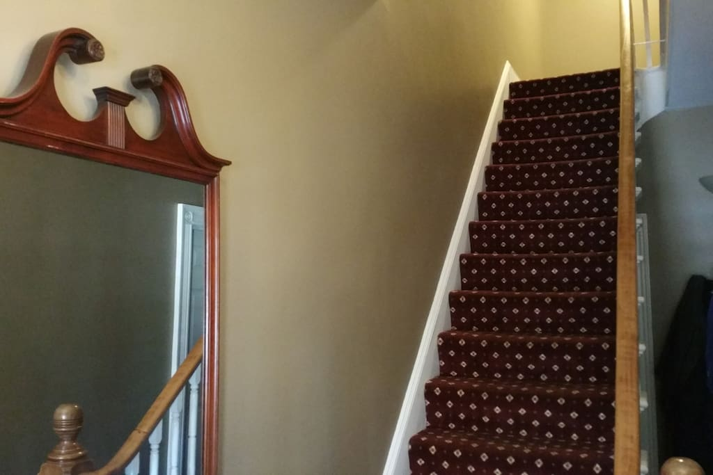 The apartment is on the second floor of an impeccably maintained 19th-century brick building.