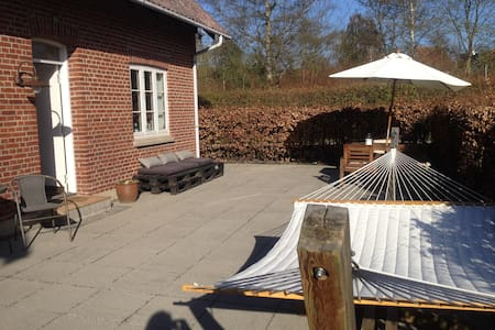 """The house is ideal for a family with kids. A large trampoline in the garden and a beautiful large terrace. the house is located by a sports field and 15 min walk to the attractive Lake in the forrest """"Skovsøen"""". Center is 5 km away."""