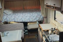Drop down bed over cab