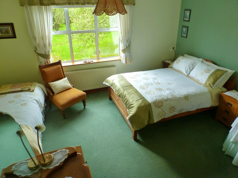 Comfortable and spacious double room overlooking the garden.