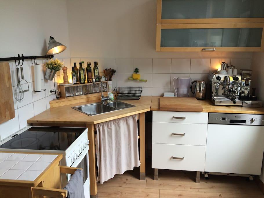 Kitchen with coffemachine and dishwasher.