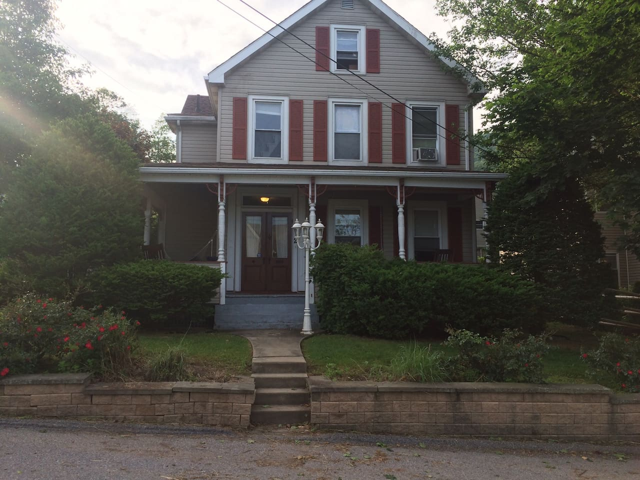 Lovely Victorian home with mature plantings.