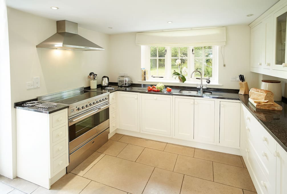 Ground floor: Limestone floors throughout large fitted kitchen