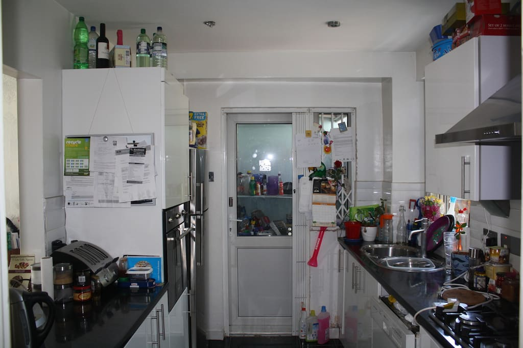 kitchen with side access to utility area, front and back garden
